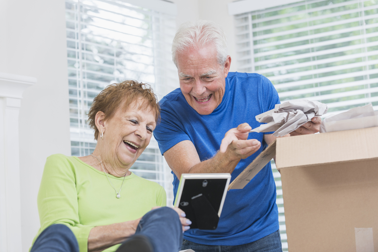 senior-retiree-couple packing-moving- in