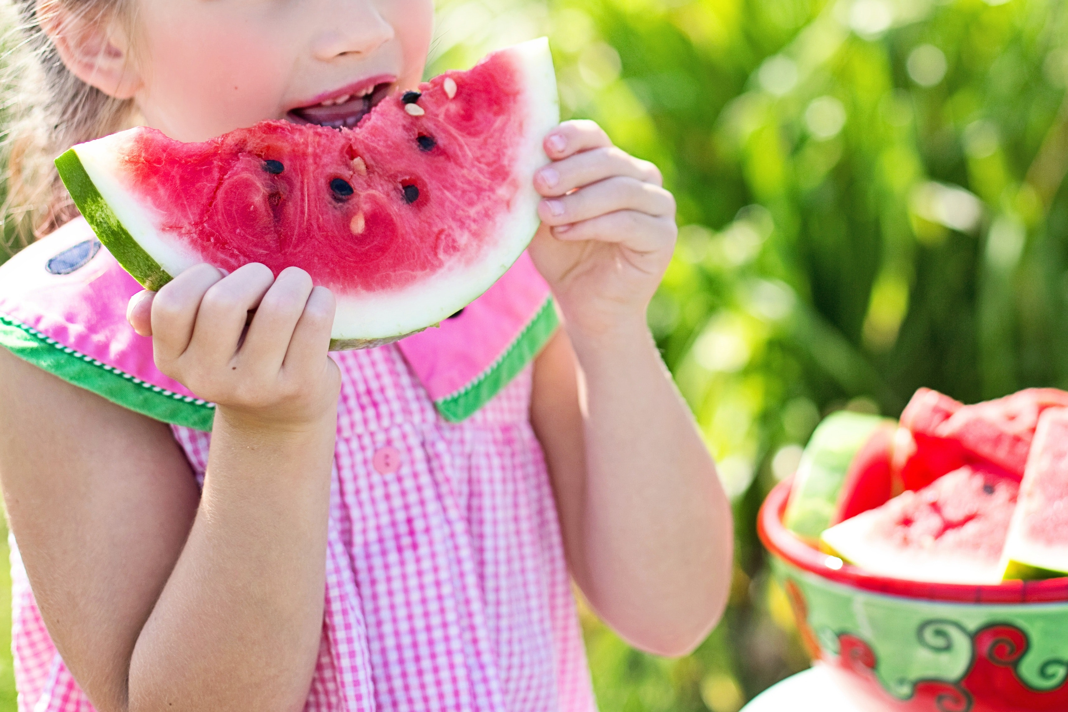 hydration- young girl eating watermellon
