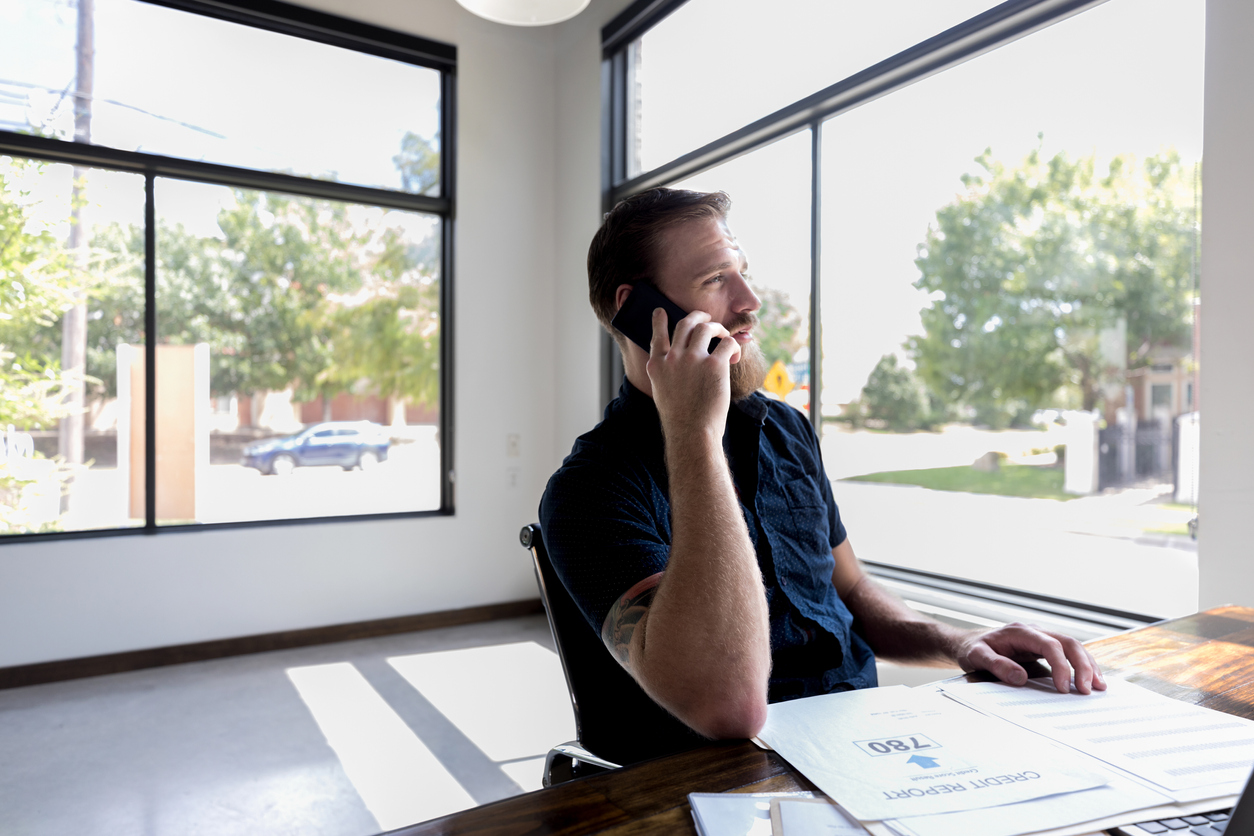 An up-close shot of a businessman calling to verify a credit inquiry to begin a removal letter if neccessary.